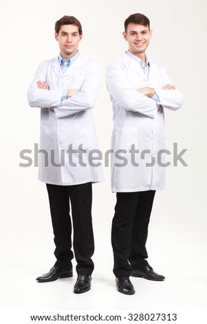 Full length portrait of two Doctors on white backround - stock photo