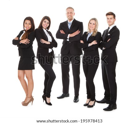 Full length portrait of welldressed businesspeople standing against white background - stock photo