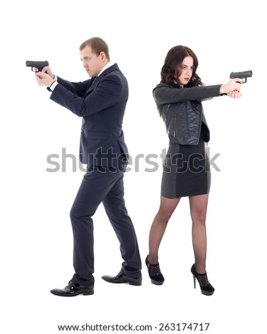 full length portrait of woman and man shooting with guns isolated on white background - stock photo
