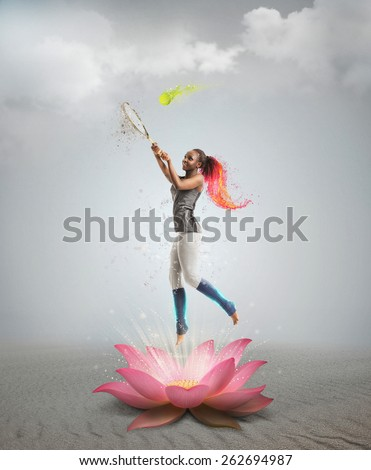 Full length portrait of young african woman playing tennis bright collage with fire and splashes in lotus flower - stock photo