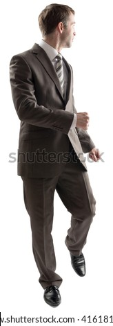Full length portrait of young business man walking while looking back, away from the camera isolated on white background - stock photo