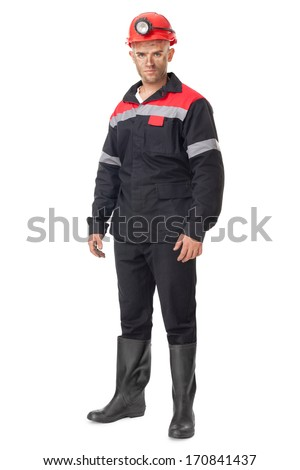 Full length portrait of young coal miner isolated on white background - stock photo