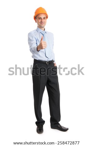 Full length portrait of young engineer wearing a helmet isolated on white background - stock photo