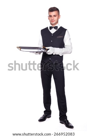 full length portrait of young happy smiling waiter with empty tray isolated on white background - stock photo