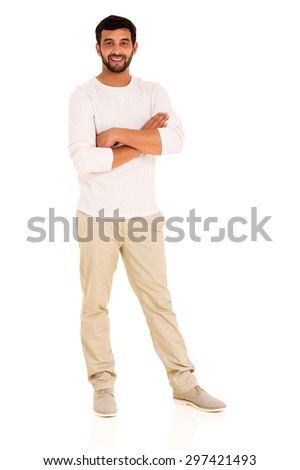 full length portrait of young indian man with arms crossed - stock photo