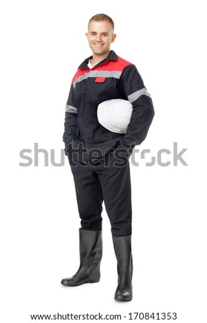 Full length portrait of young smiling engineer holding white helmet isolated on white background - stock photo