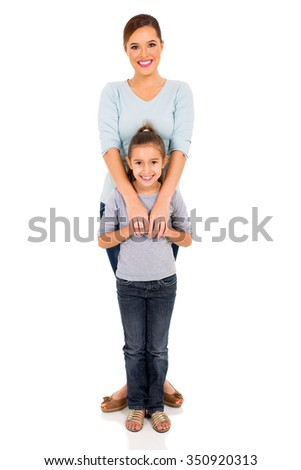 full length portrait of young woman with her little girl - stock photo