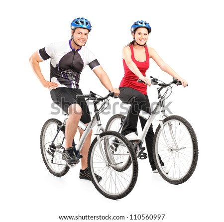 Full length portraits of young male and female bikers on a bike isolated on white background - stock photo