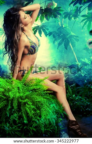 Full length portrit of a beautiful sexy woman in bikini among tropical plants. Beauty, fashion. Spa, healthcare. Tropical vacation. - stock photo