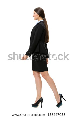 Full-length profile of walking business woman, isolated on white. Concept of leadership and success - stock photo