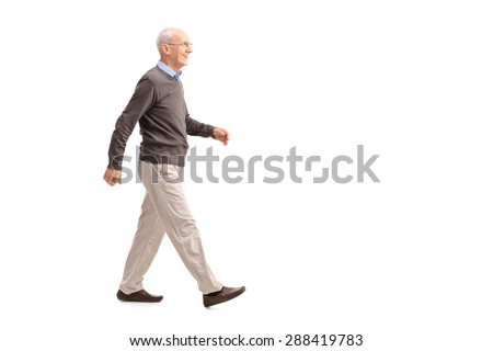 Full length profile shot of a casual senior man walking and smiling isolated on white background - stock photo