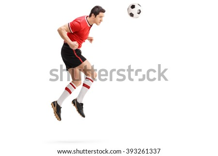 Full length profile shot of a male football player heading a ball shot in mid-air isolated on white background  - stock photo