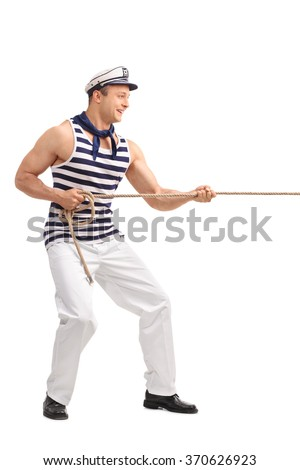 Full length profile shot of a young male sailor pulling a rope isolated on white background - stock photo