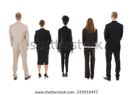 Full length rear view of business team standing against white background - stock photo