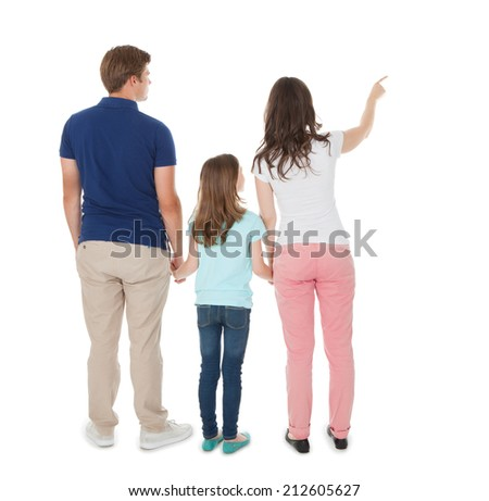 Full length rear view of woman showing something to family over white background - stock photo