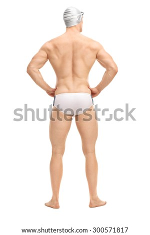 Full length rear view shot of a handsome male swimmer in white swim trunks and a gray swim cap isolated on white background - stock photo