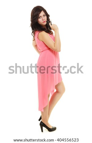 Full length sexy detective spy. Woman brunette holding gun isolated on white background - stock photo