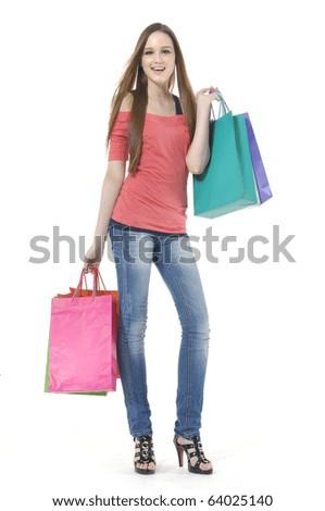 Full length shopping girl posing in the studio - stock photo