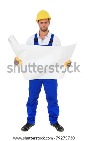 Full length shot of a construction worker studying a construction plan. All on white background. - stock photo