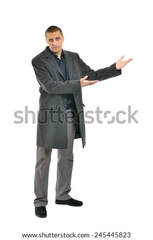 Full length shot of an attractive man pointing on white background - stock photo