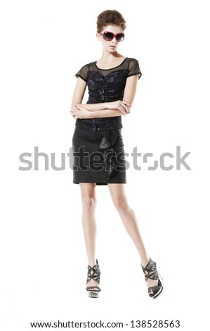 full length shot of fashion model wearing sunglasses posing - stock photo