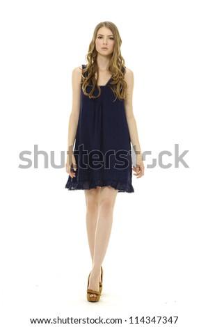 Full length shot of sexy woman in evening black dress, walking - stock photo