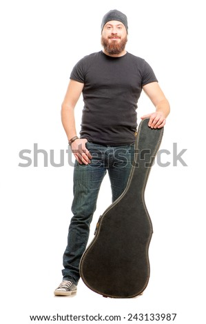 Full length shot of trendy young man posing with guitar case over white background isolated - stock photo