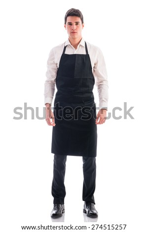 Full length shot of young chef or waiter posing, wearing black apron and white shirt isolated on white background - stock photo