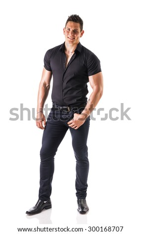Full length shot of young muscular big man wearing stylish black shirt and black jeans looking at camera, isolated on white - stock photo