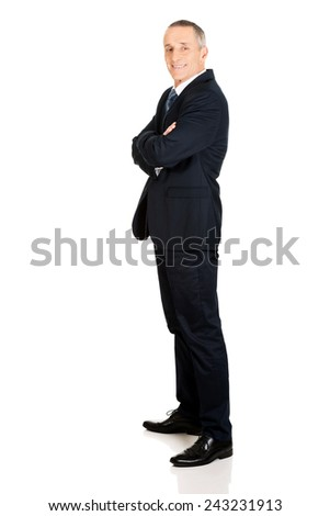 Full length side view businessman with folded arms. - stock photo