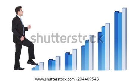 Full length side view of young businessman walking over white background - stock photo