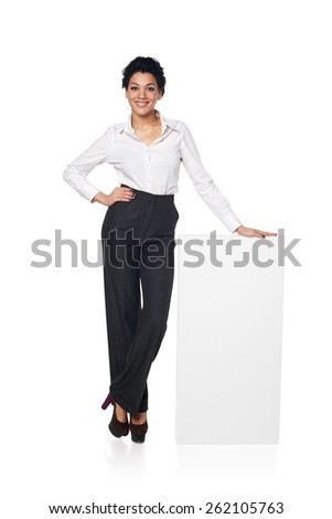 Full length smiling business woman portrait with blank white board, isolated on white background - stock photo