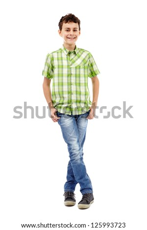 Full length studio portrait of a teen boy in green plaid shirt with hands in his pockets - stock photo