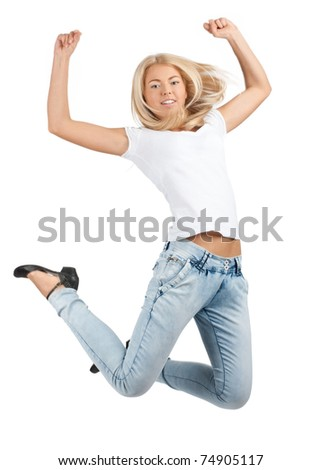 Full length studio shot of pretty young woman jumping in air. Over white background - stock photo