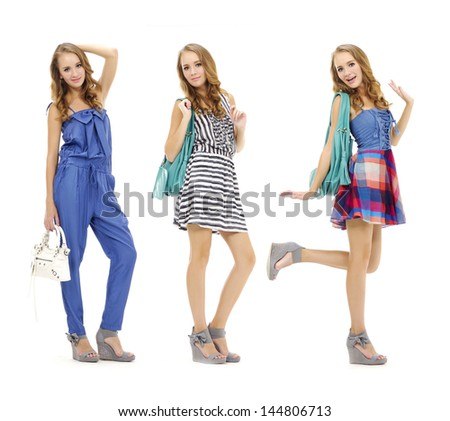 Full length three beautiful fashion woman with handbag posing in the studio - stock photo
