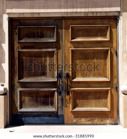 Full length weathered wooden double doors - stock photo