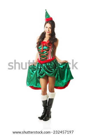 Full length woman wearing elf clothes - stock photo
