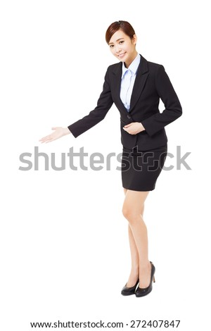 full length young  businesswoman with welcome gesture - stock photo