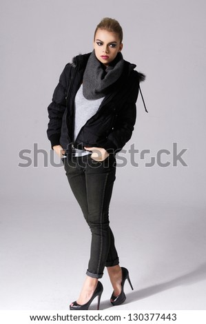 full-length young girl in jacket with scarf posing - stock photo
