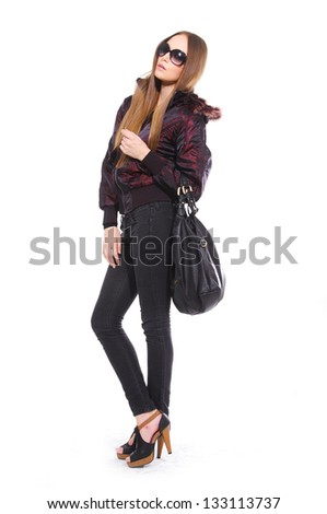 Full length young girl in sunglasses with bag posing - stock photo