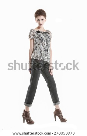 full-length young girl walking in studio - stock photo