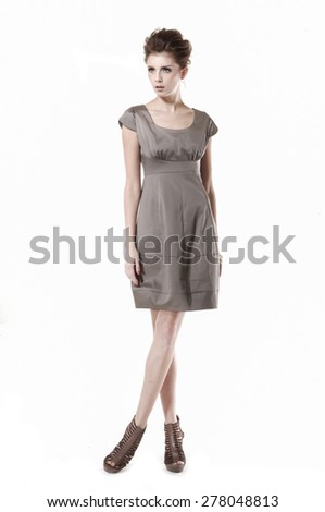full-length young girl wearing sundress standing in studio - stock photo