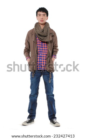 Full length Young man in jeans with scarf standing on white background - stock photo