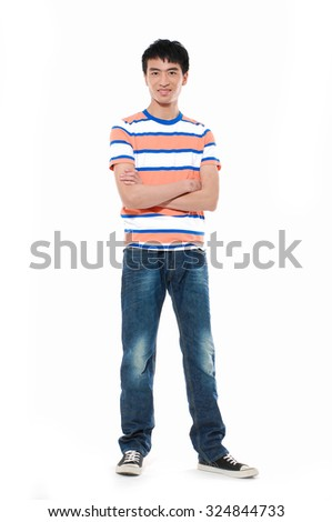 Full length young man standing in jeans posing on white background - stock photo