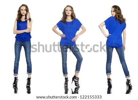 Full length young stylish three girl in jeans posing on white background - stock photo