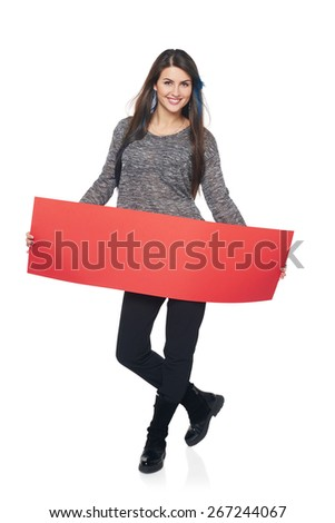 Full length young woman holding red blank cardboard, over white background - stock photo