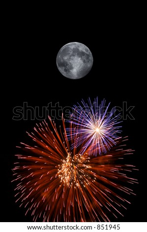 Full moon and fireworks exploding on clear night - stock photo