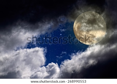 Full moon night with a hole in the clouds and stars - stock photo