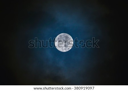 Full moon on the dark blue sky - stock photo