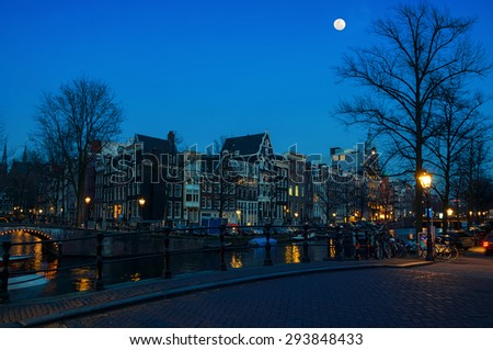 Full moon over Amsterdam, Netherlands canals and bridges. Night view of Keizersgracht and famous touristic place - stock photo